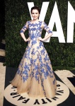 Lily Collins in a beautiful nude and blue embroidered tulle ball gown by Monique Lhuillier and Tiffany & Co. jewelry